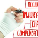 A person with an injured hand writing details about personal injury claims