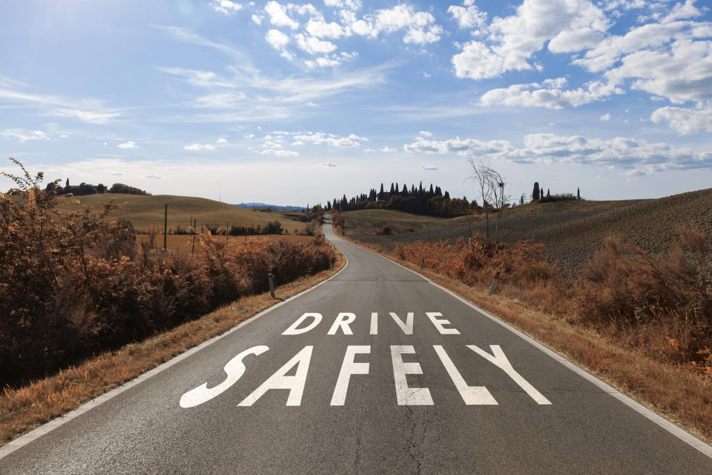 Safe driving message on the sunny road